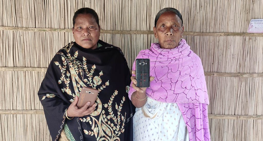 Women use mobile phones to maintain land records