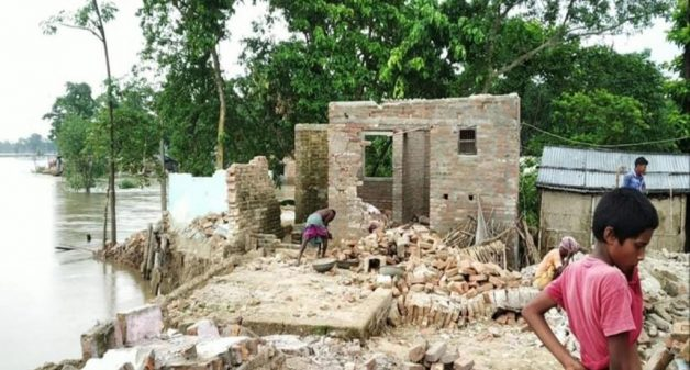 Villagers demolish flood-ravaged homes to save recyclables